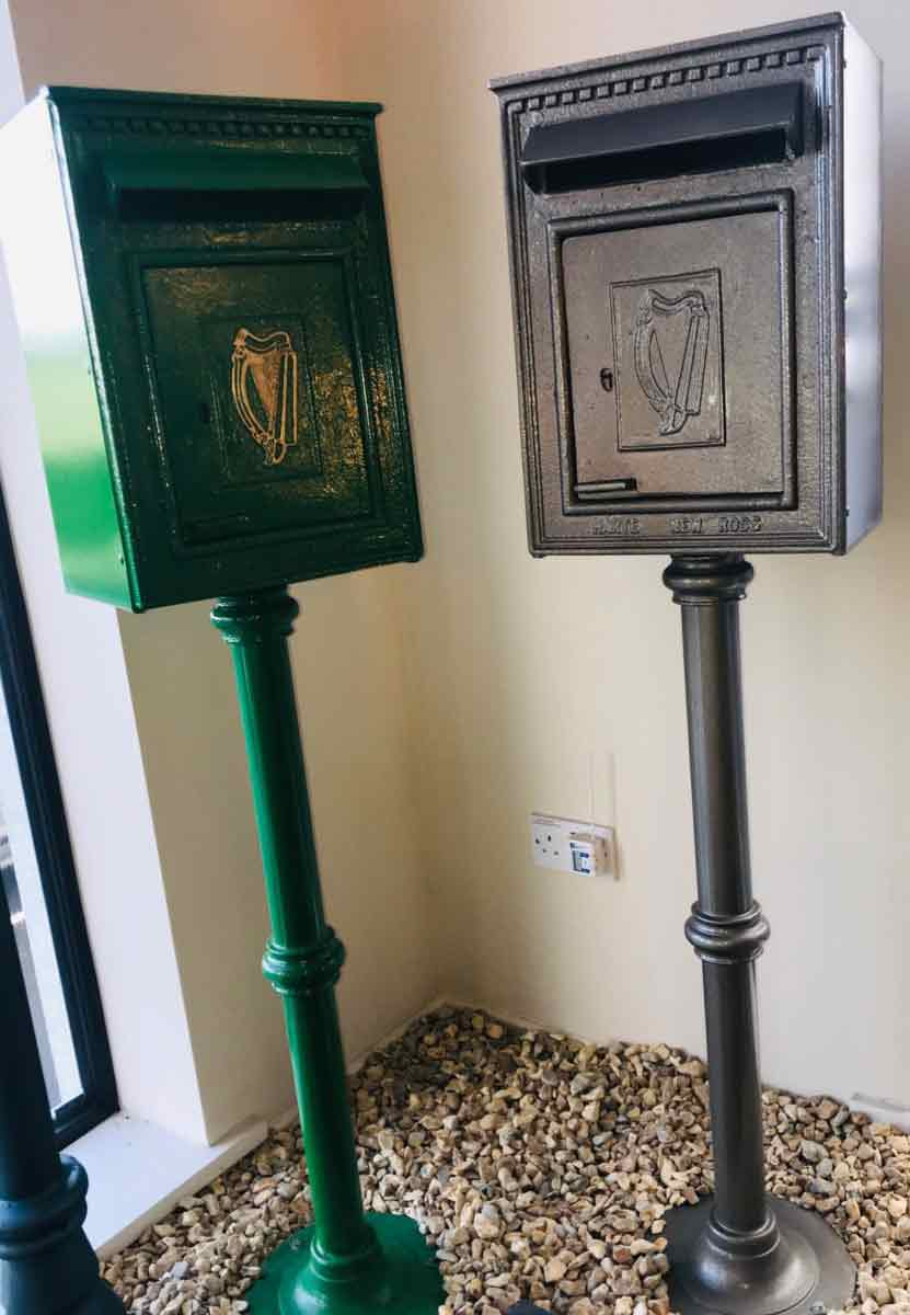 Two freestanding post boxes - one green, one grey